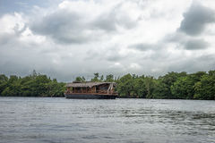 Pleasure boat on the river Bentota. Royalty Free Stock Images