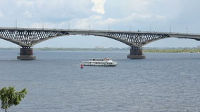 Pleasure boat on the river. Bridge on the Volga river between the cities of Saratov and Engels. Russia stock video