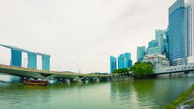 Pleasure boat in the river near bridges. Singapore Royalty Free Stock Photography