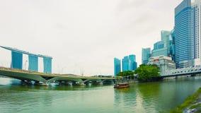 Pleasure boat in the river near bridges. Singapore. High definition video - Pleasure boat in the river near bridges. Singapore stock video