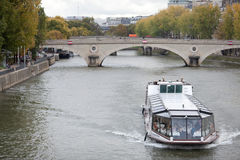 Pleasure boat on the river Seine in Paris Royalty Free Stock Photos