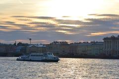 Pleasure boat sailing on the river Neva at sunset. Stock Photo