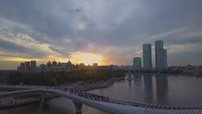 Pleasure boat sailing under the bridge in the background sunset, Astana stock footage