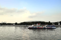 Pleasure boat sails along the Moscow River near Luzhniki Stadium Stock Image