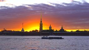 Pleasure boat sails at the Peter and Paul Fortress at sunset. Saint Petersburg stock video