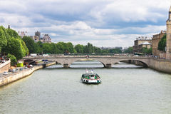Pleasure boat on the Seine in Paris. Royalty Free Stock Photo