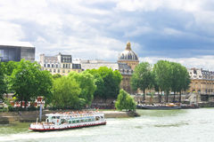 Pleasure boat on the Seine in Paris. Royalty Free Stock Image
