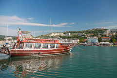 Pleasure boat with tourists. Black sea coast, Balchik town Royalty Free Stock Images
