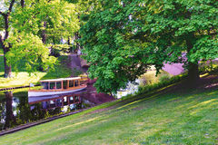 Pleasure boat with tourists on a canal in Riga in spring Stock Image