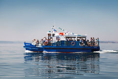 Pleasure boat with tourists goes on Black sea in Burgas bay Stock Photos