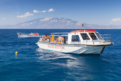 Pleasure boat with tourists goes on sea water Stock Images