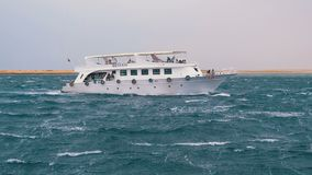 Pleasure Boat with Tourists is Sailing in the Storm Sea. Egypt, Sharm El Sheikh stock video footage