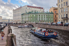 Pleasure boat with tourists in St. Petersburg Stock Photos
