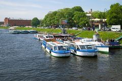 Pleasure boat tours at the pier on the Kronverksky Canal, Saint Petersburg. ST PETERSBURG, RUSSIA - MAY 22, 2016: Pleasure boat tours at the pier on the Royalty Free Stock Photo