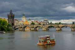 Pleasure boat on the Vltava river in Prague, Czech Republic. Bohemia Royalty Free Stock Photos