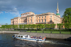 Pleasure boat on the water tours at the Mikhailovsky castle. Saint Petersburg Stock Images