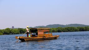 The pleasure-boat and the West Lake Royalty Free Stock Photos