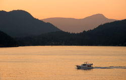 Pleasure boat, West Vancouver, BC. Pleasure boat at sunset, West Vancouver, BC Royalty Free Stock Photo