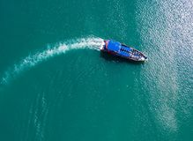 Free Pleasure Boat With Tourists On Board Floating In The Sea, The Trail With Waves Behind, Top View From The Drone Royalty Free Stock Photo - 164784105