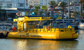 Pleasure boat Yellow submarine at the dock fishing harbor royalty free stock photography