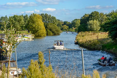 Pleasure boating on the river Lys in summer. Astene, Belgium 27 September 2015: Pleasure boating on the Lys river in Flanders on a sunny Sunday Royalty Free Stock Photography