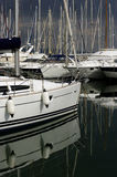 The pleasure boats. Pleasure boats docked in the port of Giens, south of France, by a stormy day Royalty Free Stock Images
