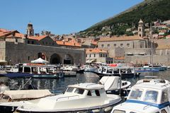 Pleasure boats in the bay of the old city of Dubrovnik in Croatia, Europe. stock image