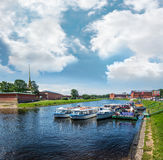 Pleasure boats are berthed in Kronverk Strait near the Peter and Royalty Free Stock Image