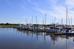 Pleasure Boats Docked in Southport. Pleasure boats docked at Southport harbor in North Carolina during the summer royalty free stock images