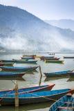 Pleasure boats on Fewa Lake in Pokhara Royalty Free Stock Photo