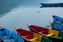 Pleasure boats at Fewa lake in Pokhara Nepal royalty free stock photography