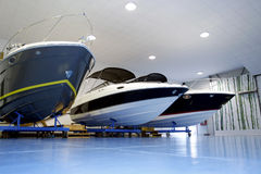 Pleasure boats in garage stock images