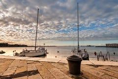 Pleasure boats in harbor. Pleasure boats moor  in harbor with bollard Royalty Free Stock Image