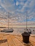Pleasure boats in harbor. Pleasure boats moor  in harbor with bollard Stock Photography