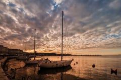 Pleasure boats in harbor. Pleasure boats moor  in harbor at sunset Stock Photo