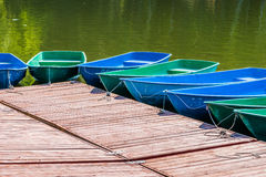 Pleasure boats for hire tied up to a wharf. Waiting for clients on a hot summer day Royalty Free Stock Images