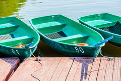 Pleasure boats for hire wait for clients. Equpipped with rubber mats, oars, and safety rings Stock Photo