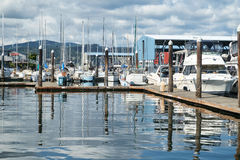 Pleasure boats in marina. Port Orchard, WA, USA September 4, 2016: Pleasure boats of all types and sizes in Port Orchard marina under sunny, cloudy skies Royalty Free Stock Photos