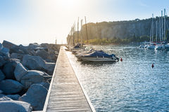 Pleasure boats moored in the harbor. Stock Photos