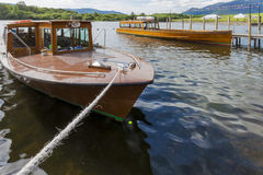 Pleasure Boats moored to jetty on Derwent Water, Keswick. Stock Images