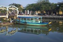 Pleasure boats moored at the town bridge. Morning Hoi An, Vietnam Royalty Free Stock Photos