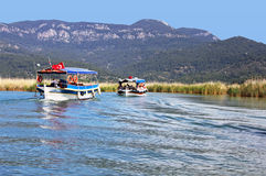 Pleasure boats motor up the Dalyan river, Turkey Stock Image