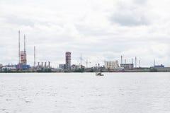 Pleasure Boats Near Water Treatment Plant.  Stock Photography