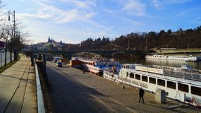 Pleasure boats parked on the Vltava pier in Prague stock image