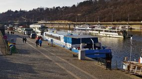 Pleasure boats parked on the Vltava pier in Prague stock photography