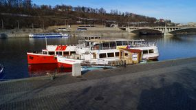 Pleasure boats parked on the Vltava pier in Prague stock photo