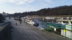 Pleasure boats parked on the Vltava pier in Prague stock images