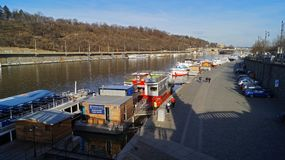 Pleasure boats parked on the Vltava pier in Prague royalty free stock photography