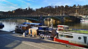 Pleasure boats parked on the Vltava pier in Prague royalty free stock image