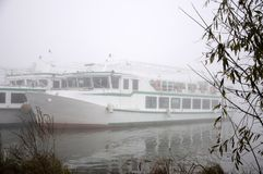 Pleasure boats on the pier, autumn morning. Pleasure boats on the pier, foggy autumn morning stock photography